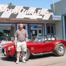 Larry in front of store with red roadster