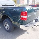 Ford truck with rear quarter panel damage